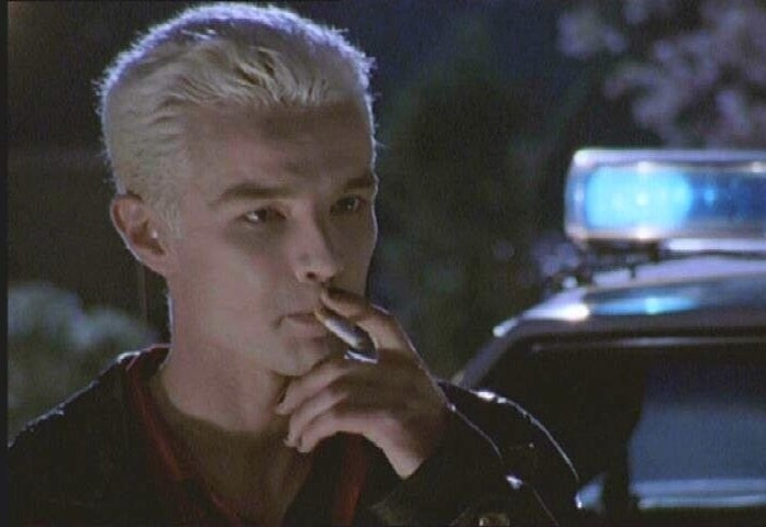 Spike smoking a cigarette