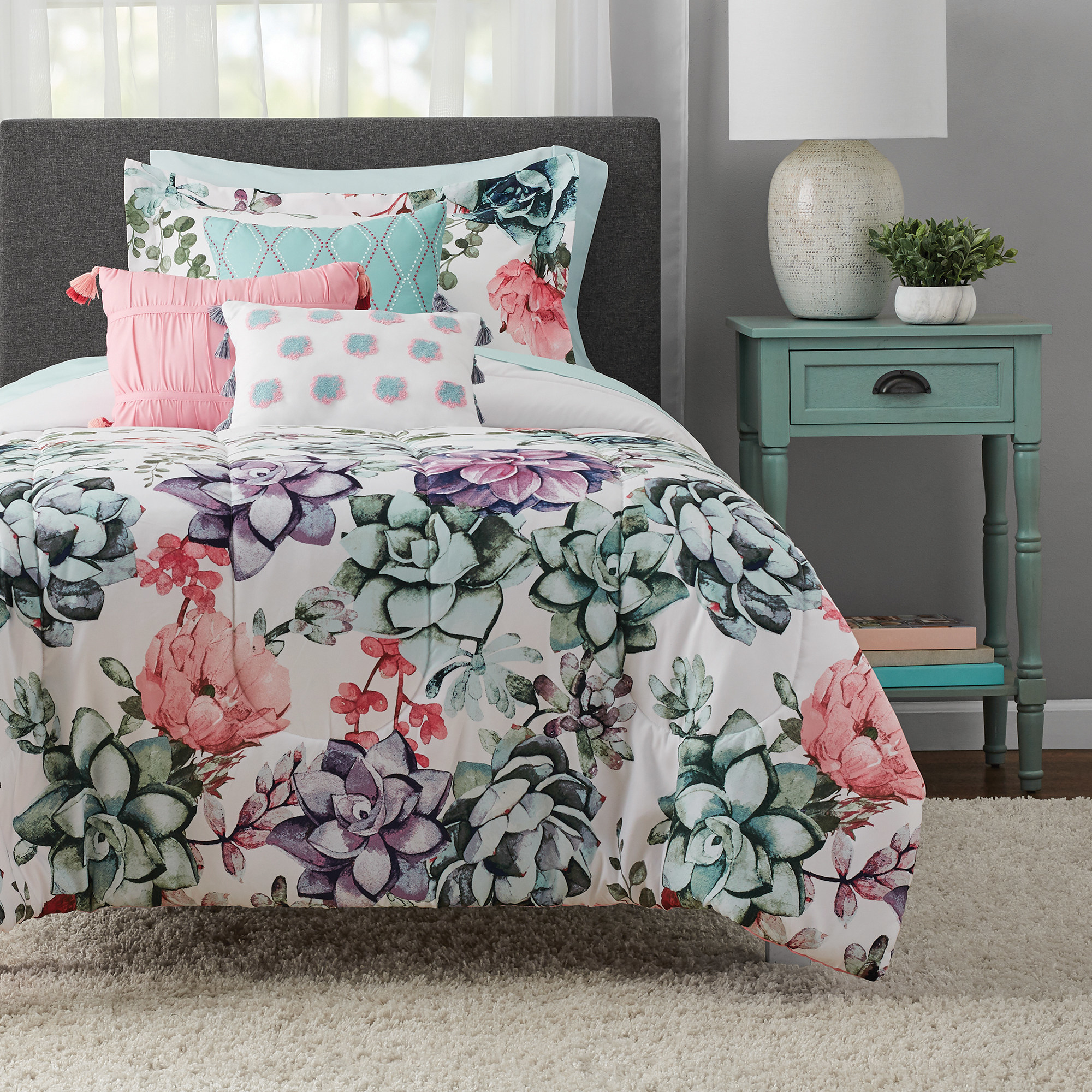 the white, pink, blue, and purple succulent bedding