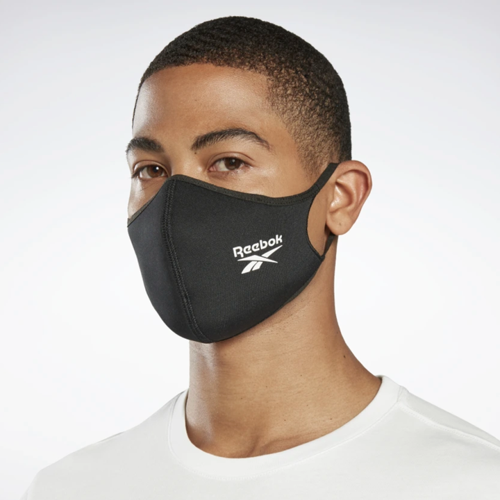 A model in a black Reebok mask with a logo