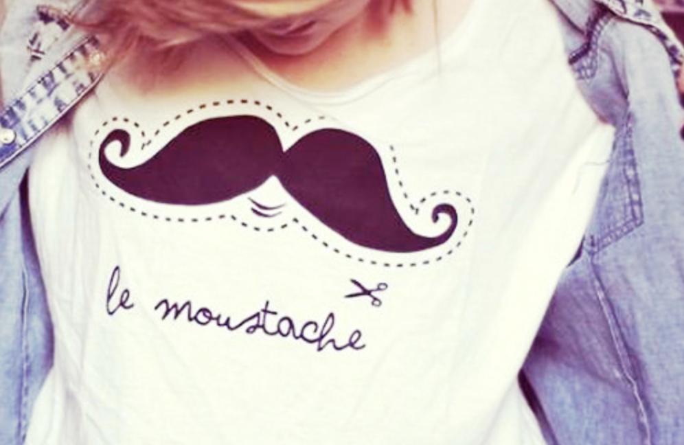 Girl wearing a mustache shirt