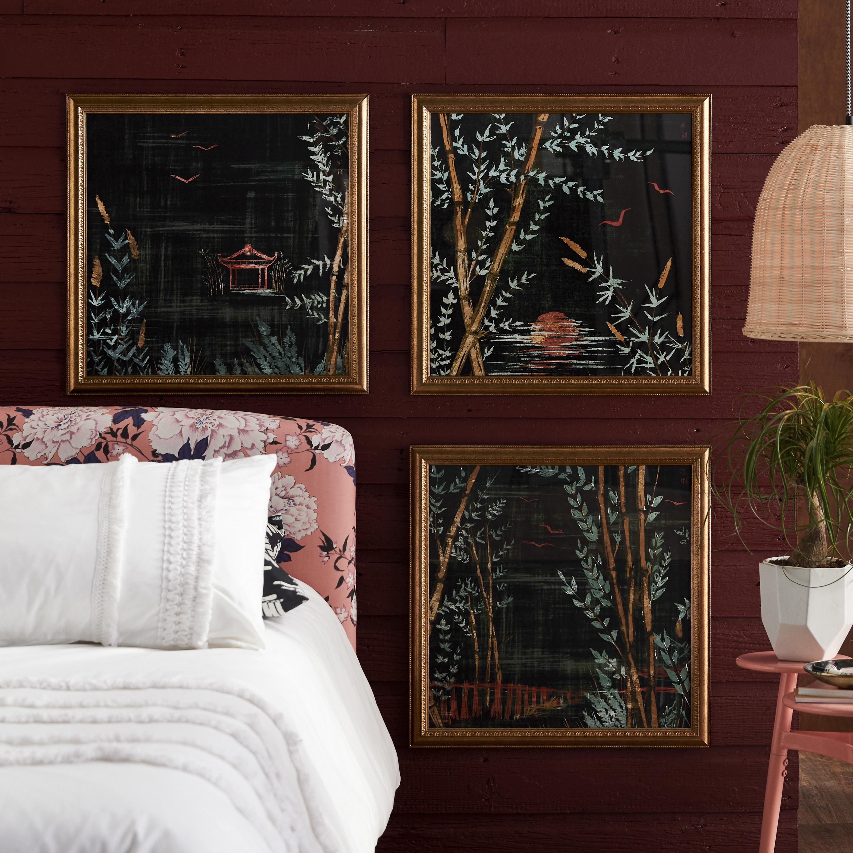 gold-framed lake prints
