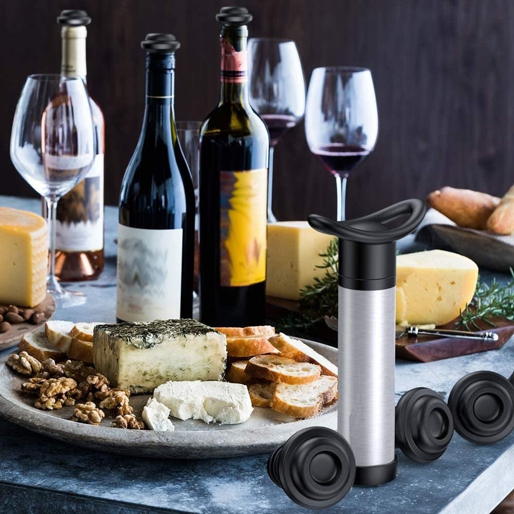 A vacuum pump sealer on a table wine wine and food