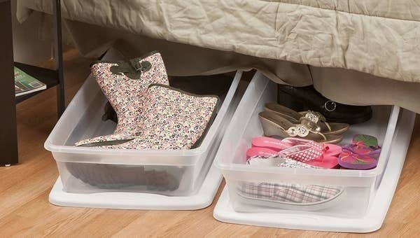 The storage boxes with shoes inside
