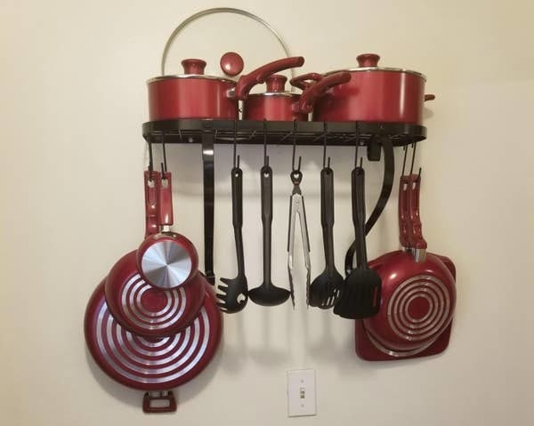 A reviewer photo of the pot rack in black