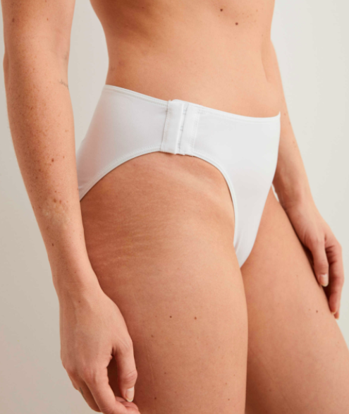 person wearing a pair of white bikini underwear with clasp at the hip that's like a bra hook