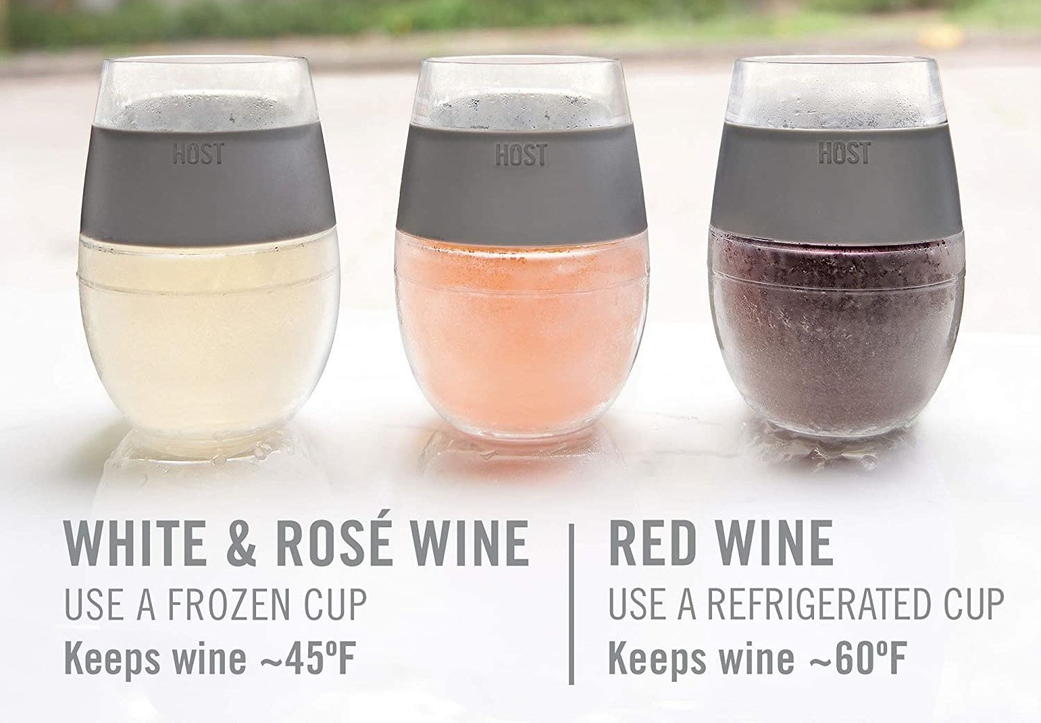 Three frosty glasses have white rosé and red wine in them