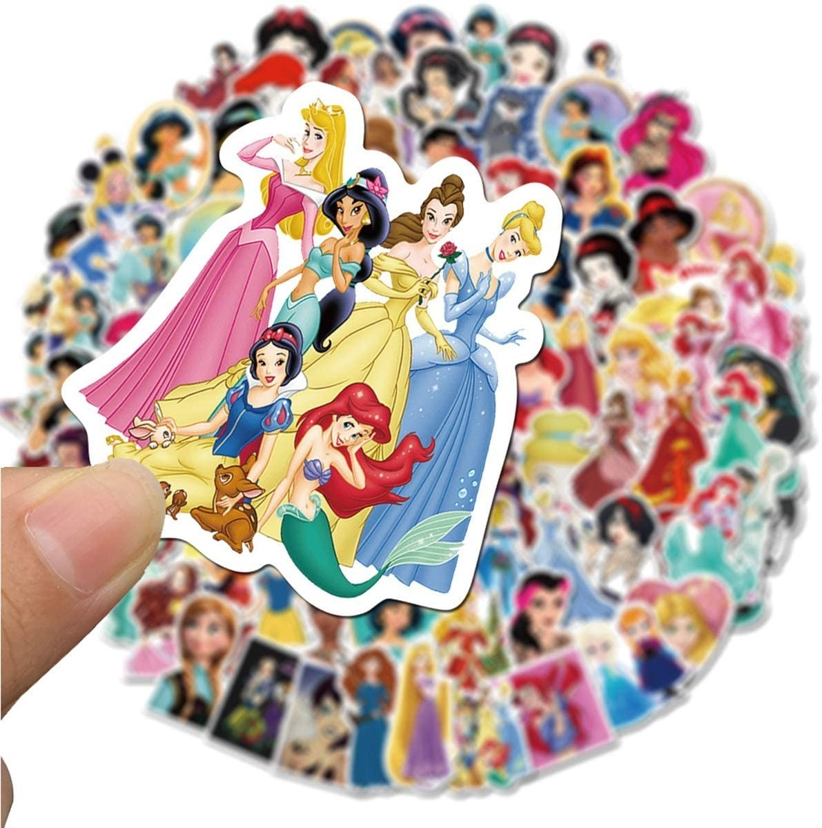 a model holding up a sticker of all the disney princesses over a pile of stickers