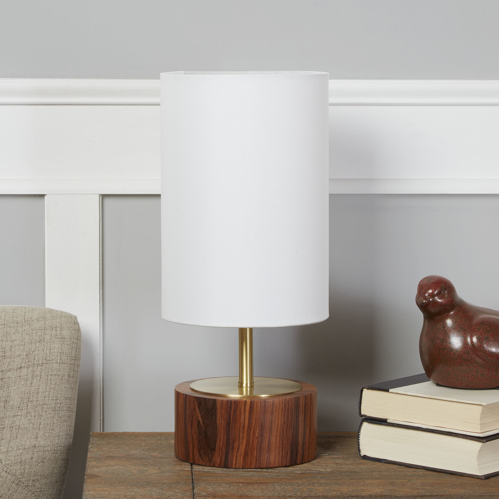 the lamp with an oak base and white shade