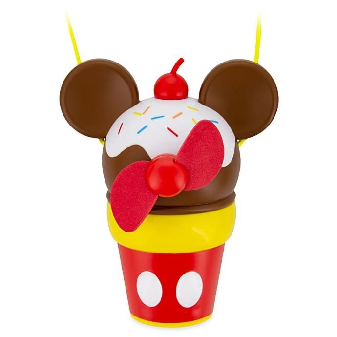 The fan, which has blades on what looks like a scoop of ice cream with Mickey ears and a cherry top in a cup printed with the design of Mickey's pants