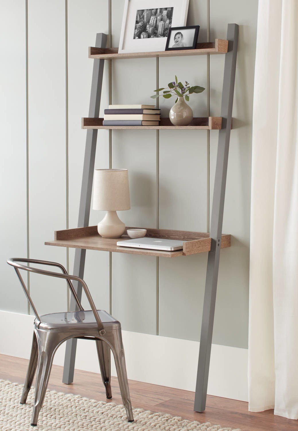 the gray brown leaning desk with three shelves