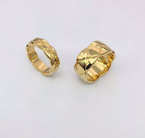two gold tone rings with a criss cross design