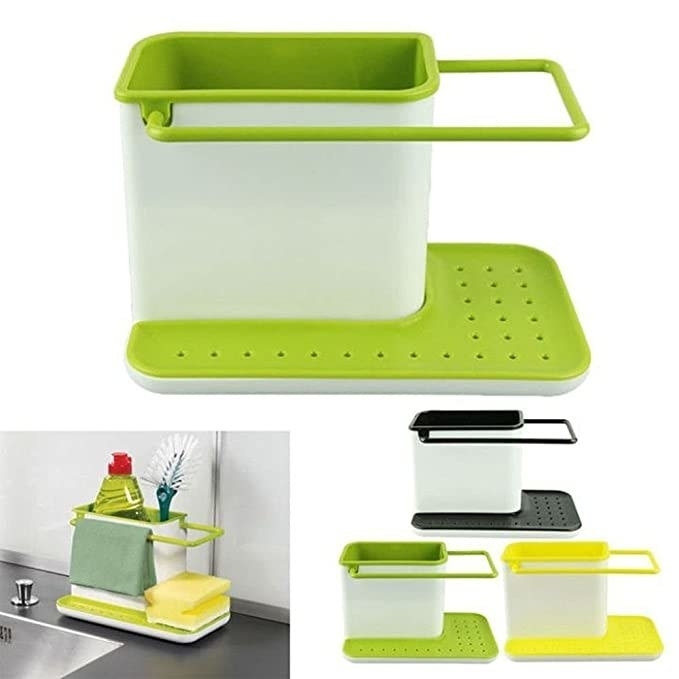 Green sink caddy with liquid detergent, a sponge, and a cleaning brush in it.