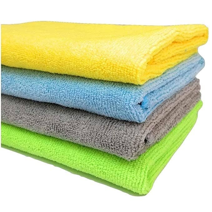 Yellow, blue,grey and green kitchen towels.