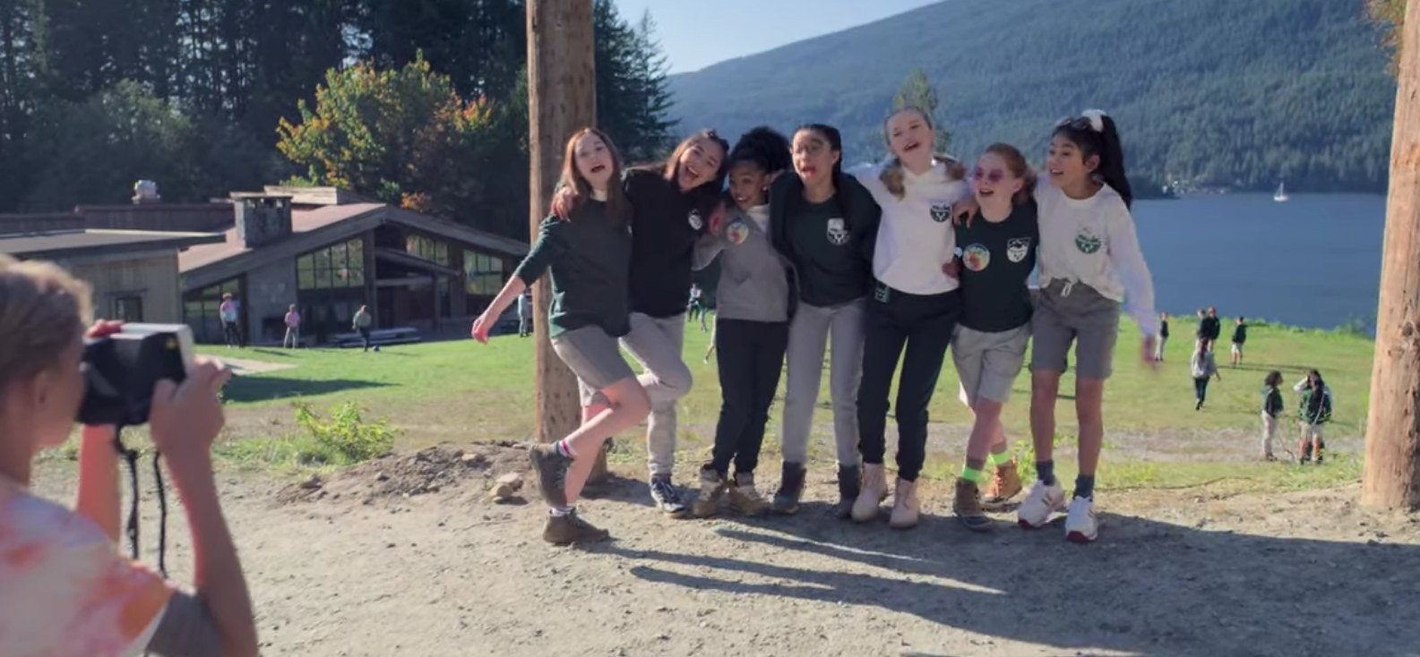 The Baby-Sitters club poses for a photo at Camp Moosehead.