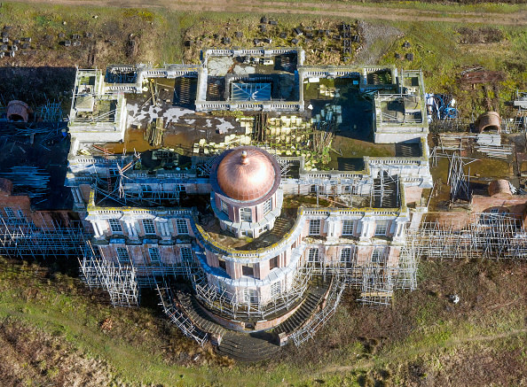 aerial view of mansion with scaffolding