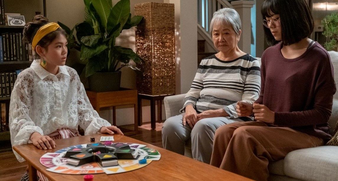 Claudia, Mimi, and Janine play Trivial Pursuit.