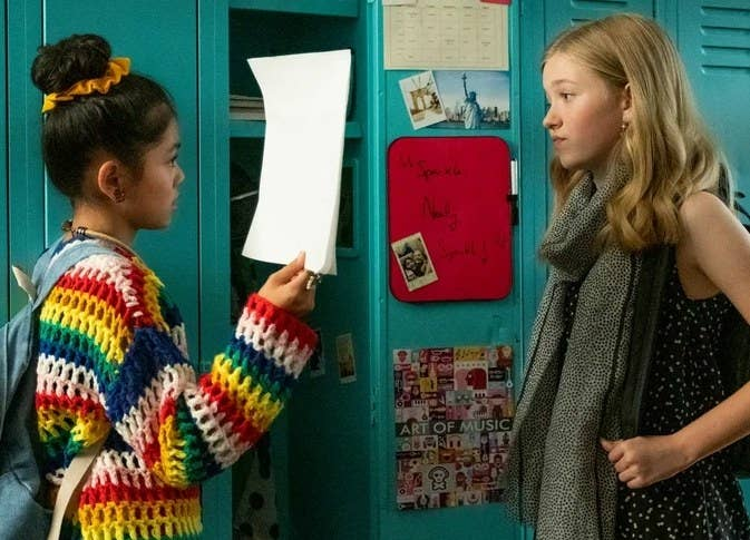 Claudia and Stacey talk in front of the lockers.
