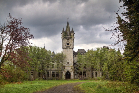 Gothic castle surrounded by trees with large central tower