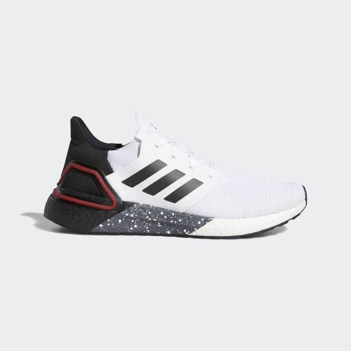 Pair of white Adidas sneakers with speckled bottom