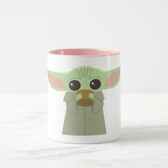 Mug with Baby Yoda drinking from a cup on it