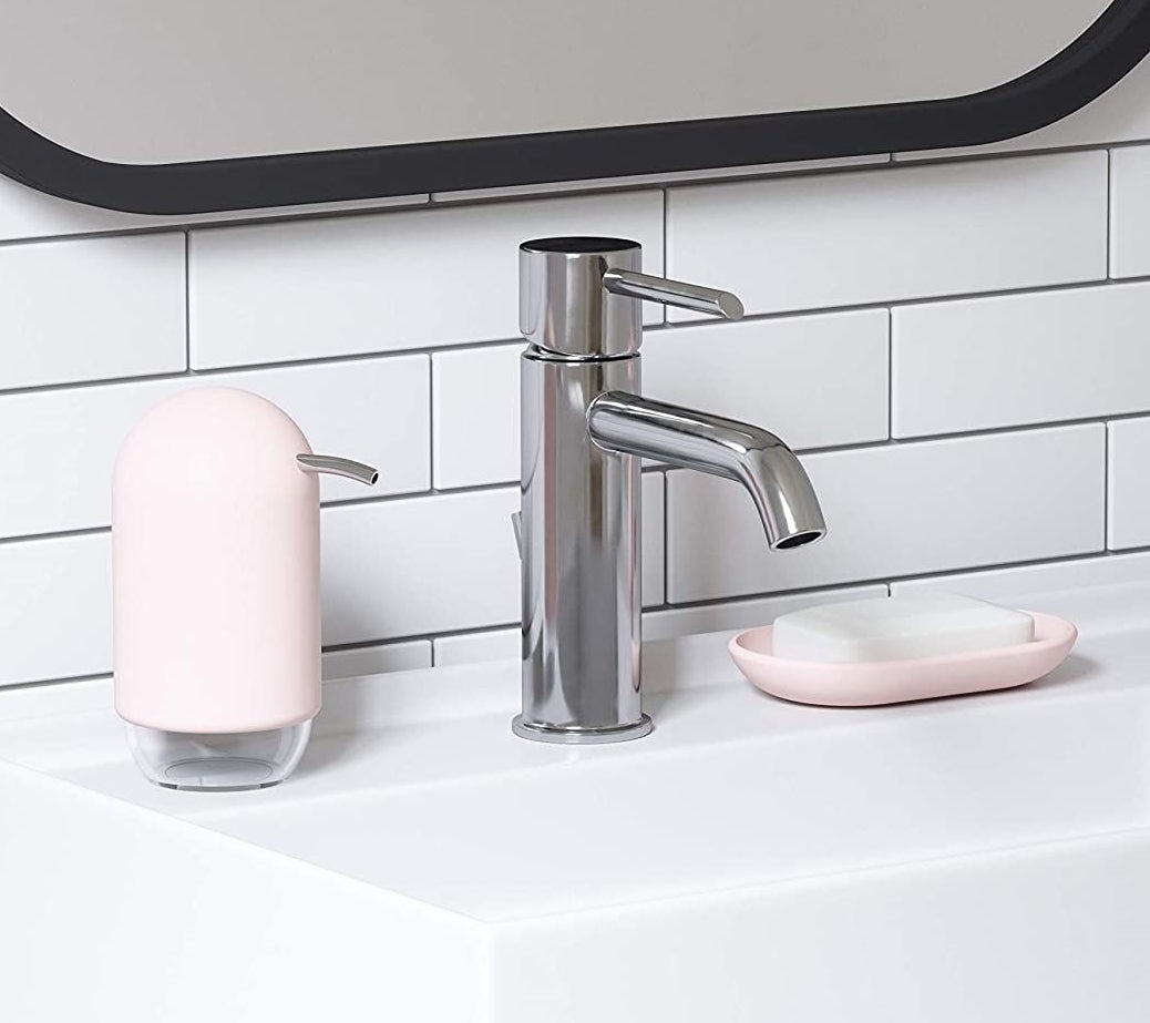 the light pink soap dispenser on a bathroom vanity