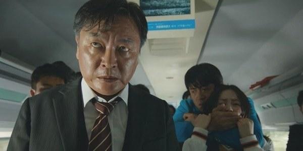 Yon-suk worn out and stressed while taking everyone hostage on the bus