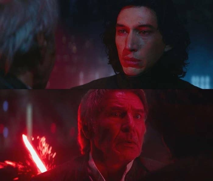 Kylo Ren stabbing Han Solo with a lightsaber with a sad look on his face; Han is shocked, but helpless