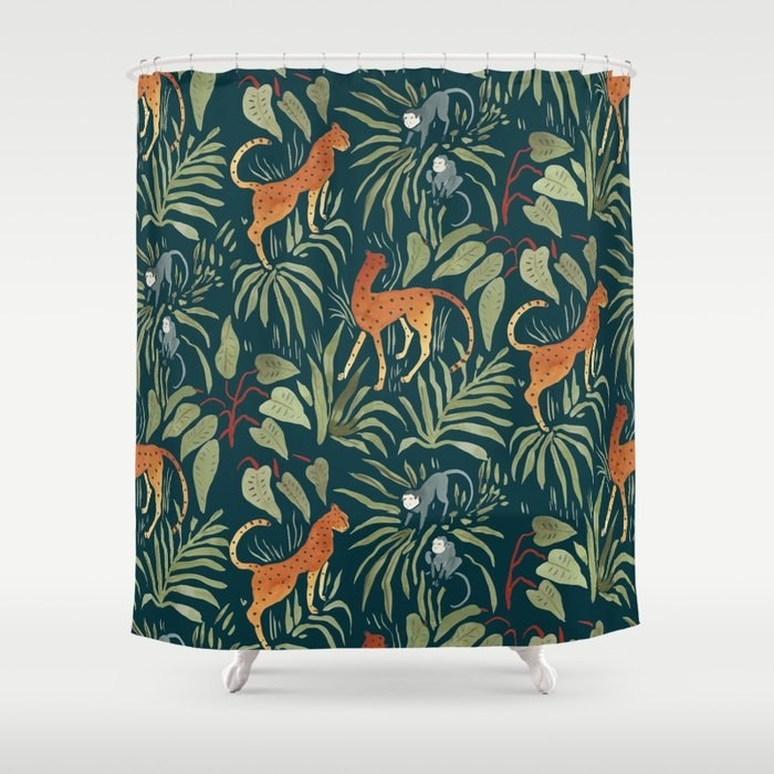 A green jungle-themed shower curtain