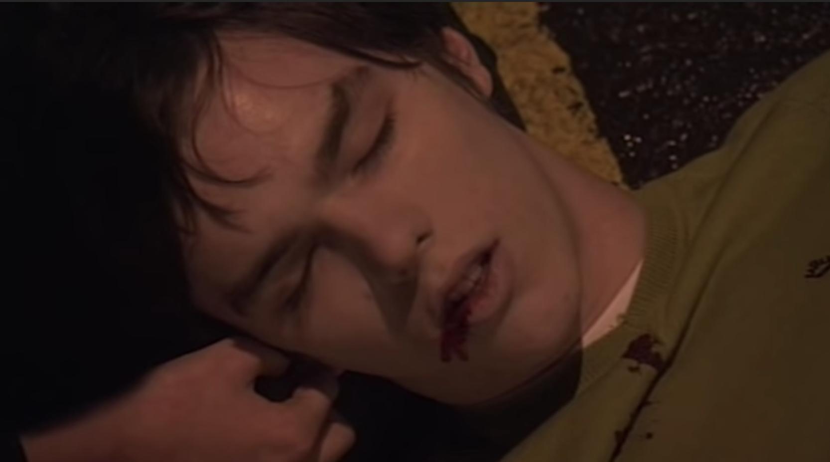 Tony lying on the ground bleeding