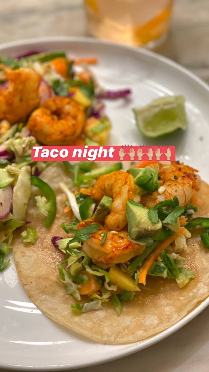 Two shrimp tacos tossed with slaw, avocado, and cilantro.