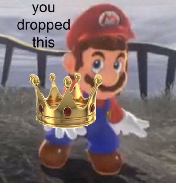 Mario from the video game Super Mario holds out a crown