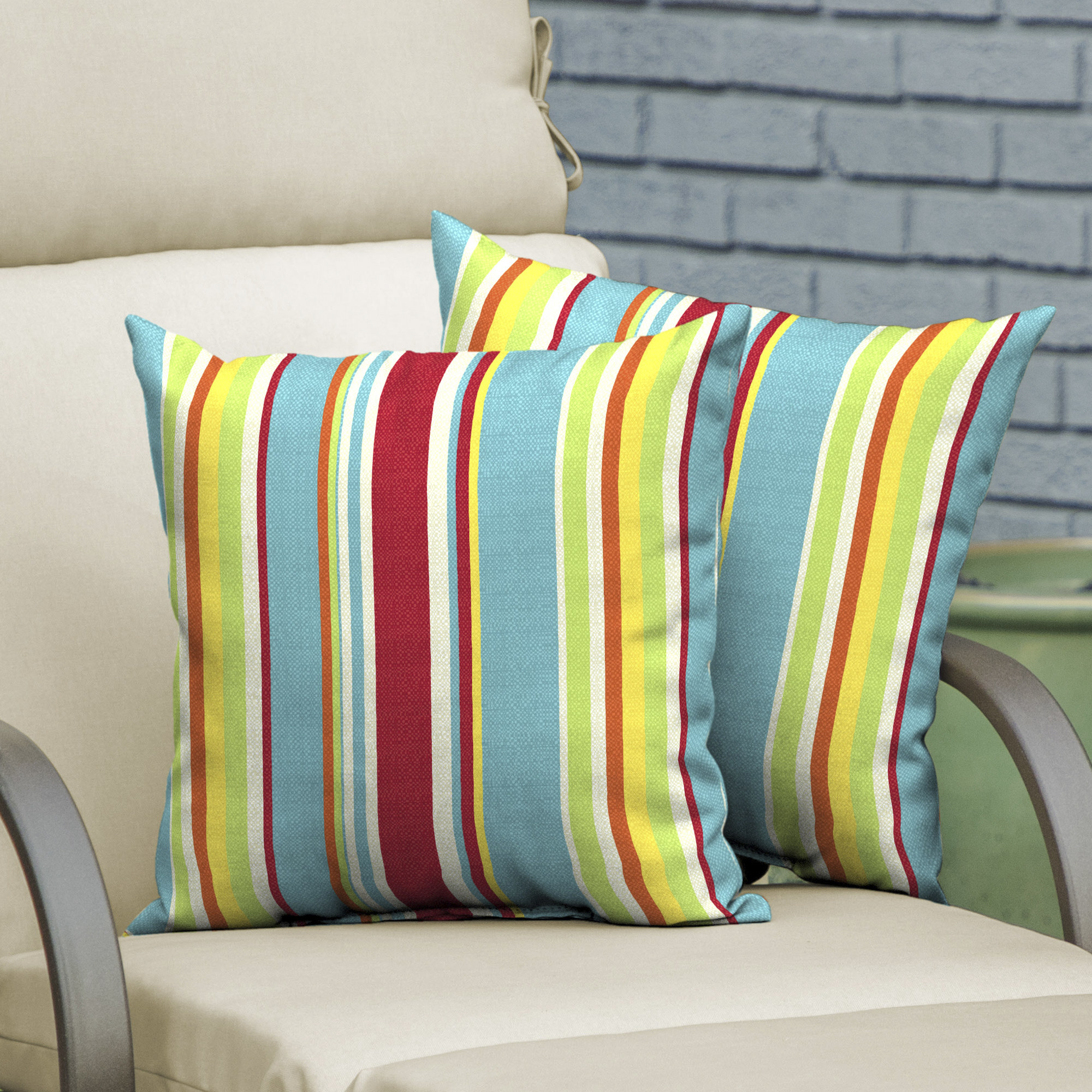 A brightly-colored set of striped outdoor pillows