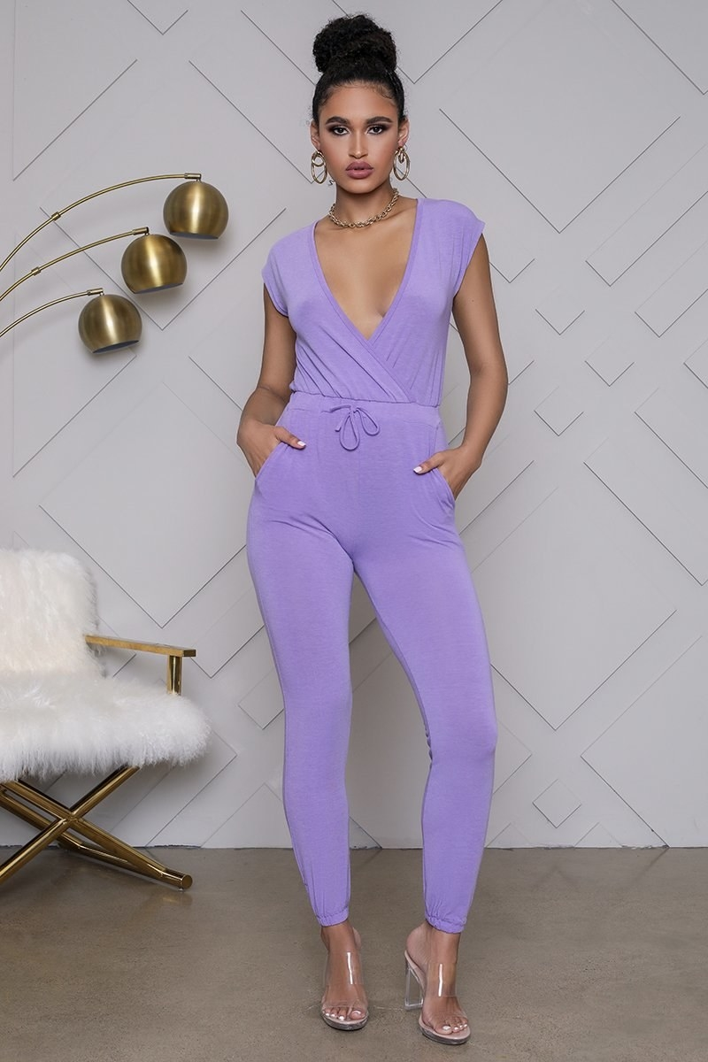 model wearing purple sleeved jumpsuit