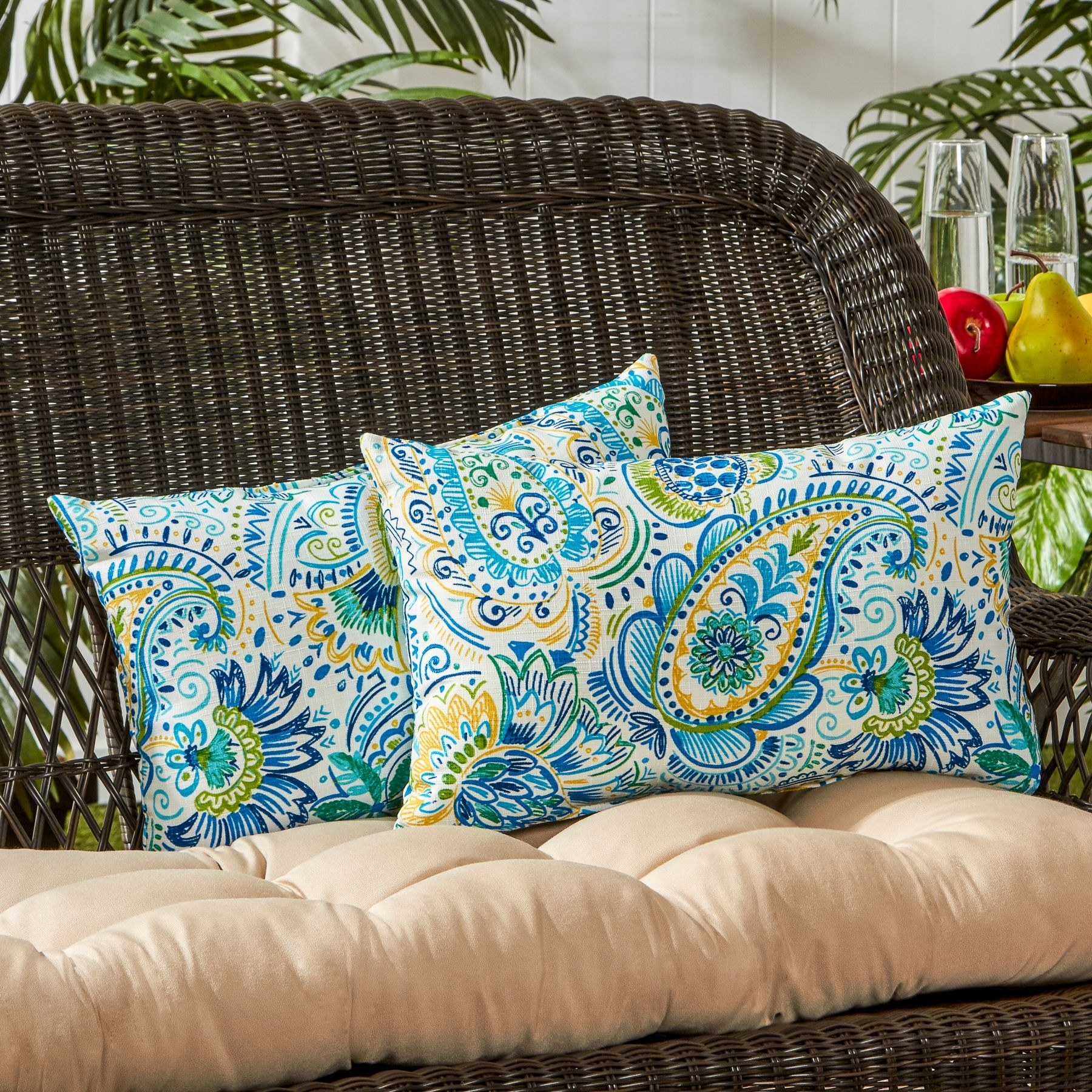 A set of blue, green, and yellow paisley outdoor pillows