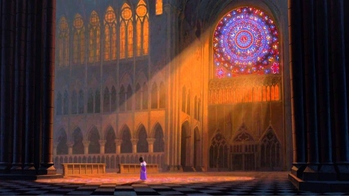 Esmeralda standing in the light of the stained glass in Notre Dame