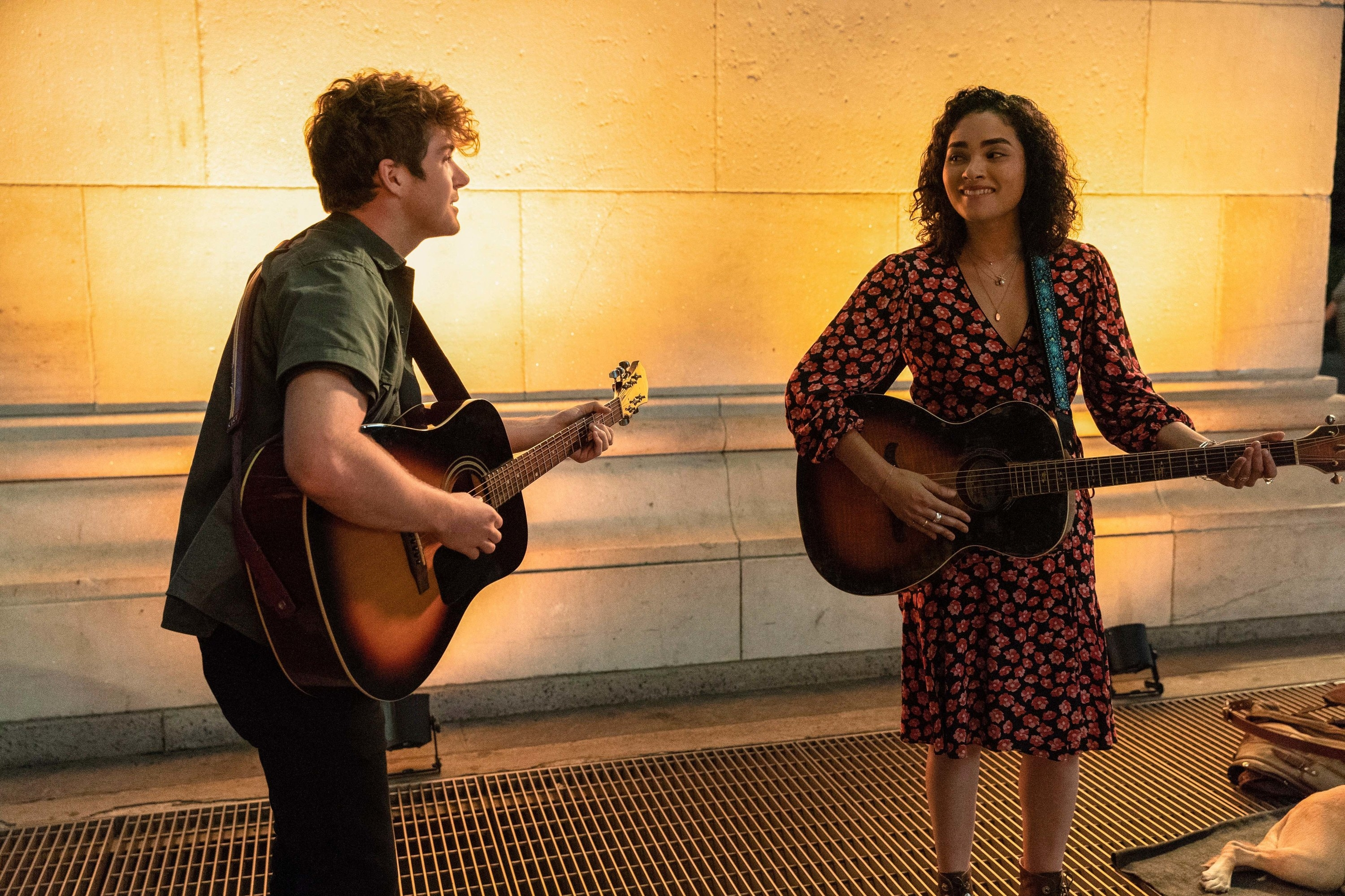 Colton Ryan and Brittany O'Grady as Samuel and Bess singing and playing guitar together