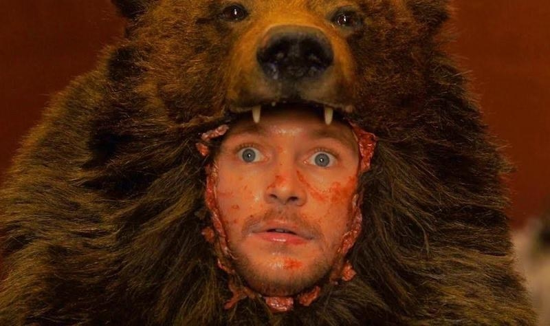 Christian looking shocked because he's been put into a bear carcass