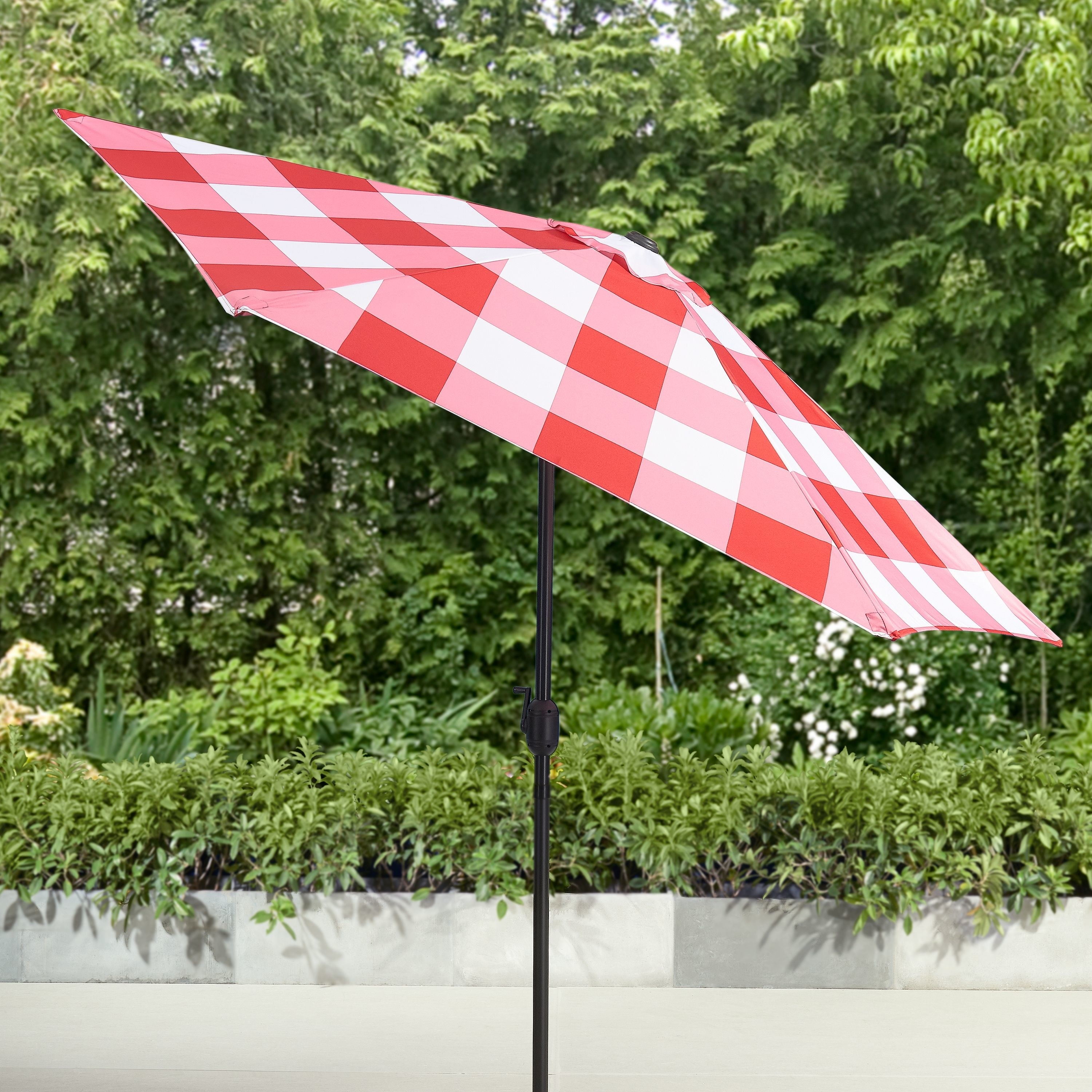 A red gingham umbrella with a black metal pole