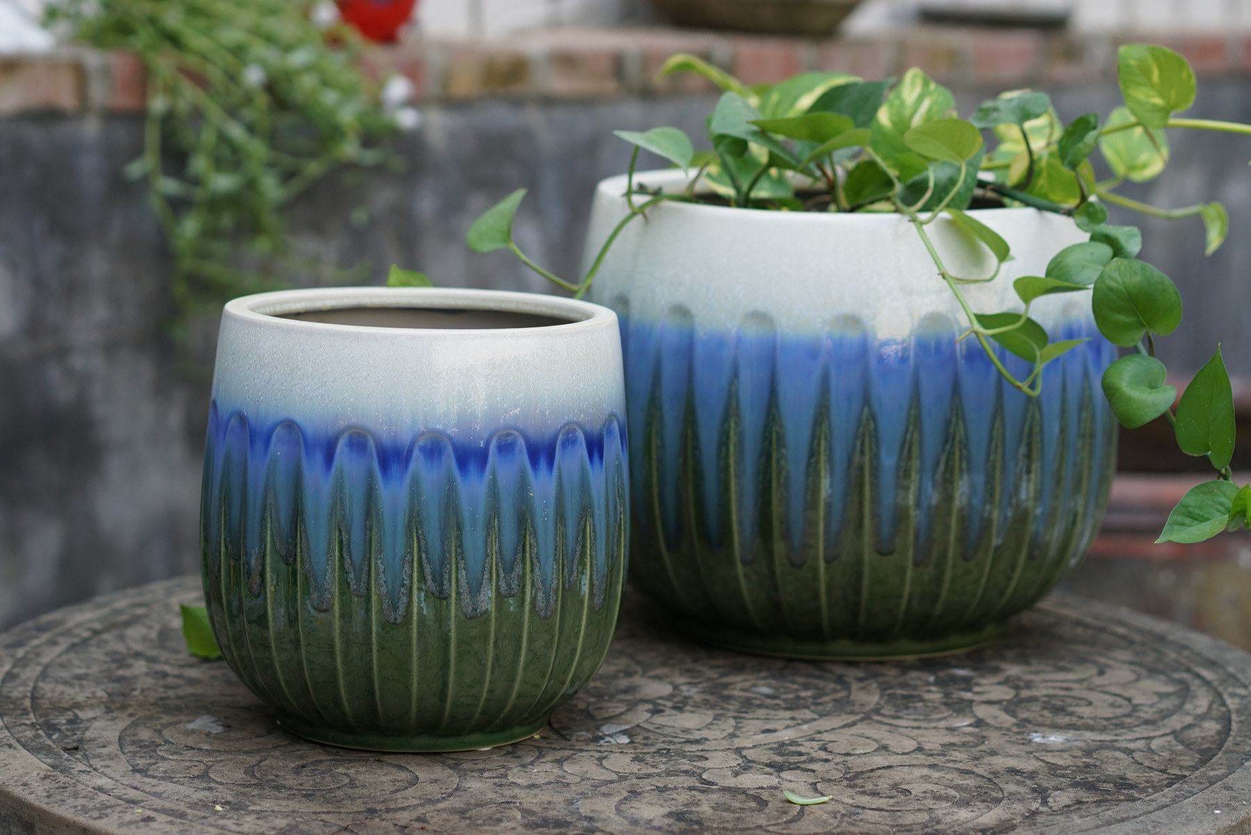 A blue, green, and white-colored ceramic planter