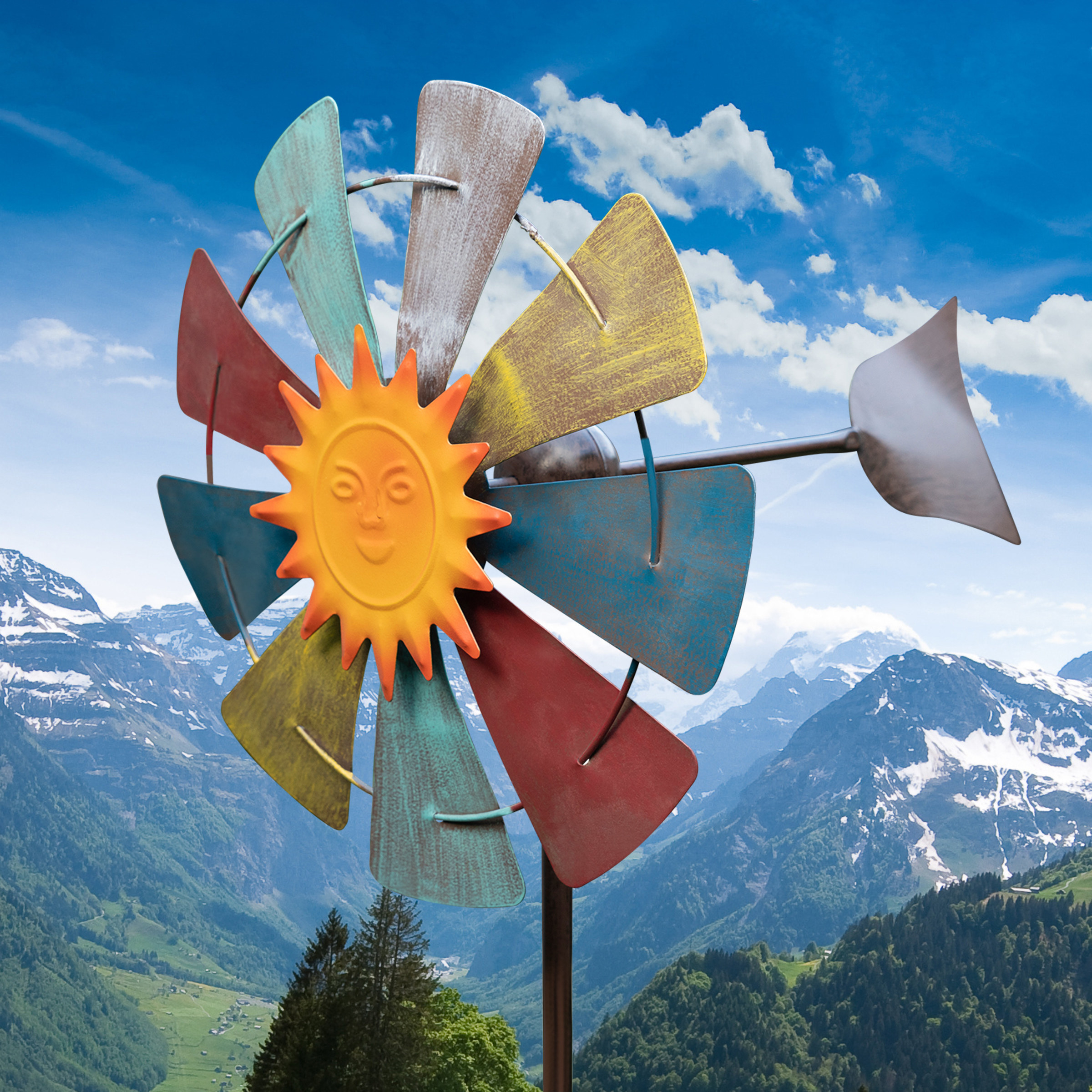 A multi-colored windmill with a smiling sun at the center