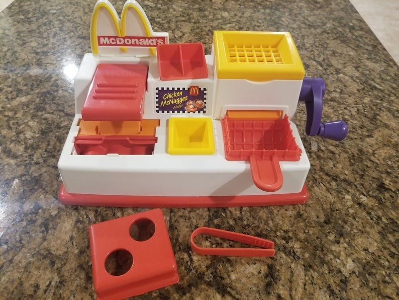 A red and white McDonald's Chicken McNugget Play-Doh play set