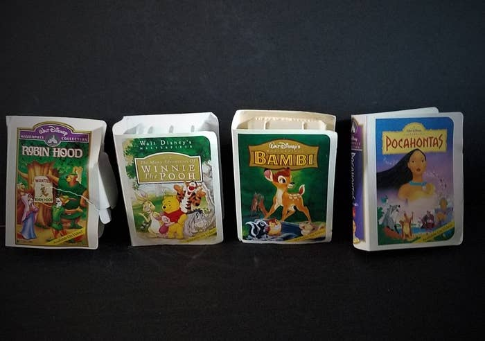 Mini-VHS Happy Meal cases of Robin Hood, Winnie the Pooh, Bambi, and Pocahontas