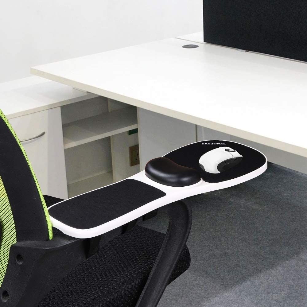 A wrist rest on the arm of a chair with a mouse on top of it