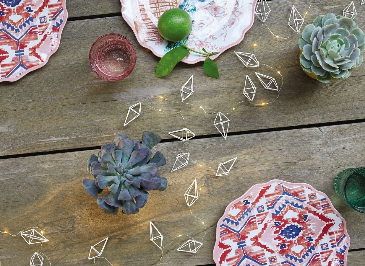 A string of outdoor string lights shaped like diamonds
