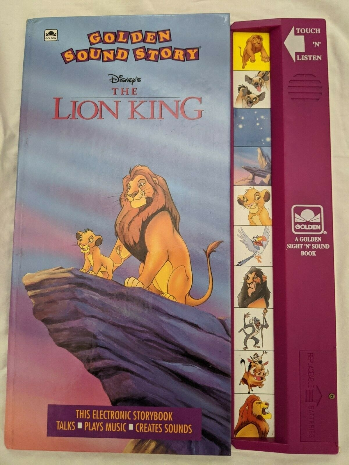 A photo of a Lion King Disney Golden Sound Story book, which has a purple touch pad with the characters faces on it.