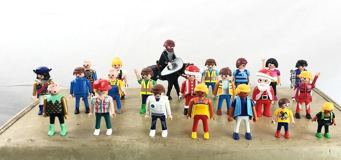 18 different Playmobil figures all standing up