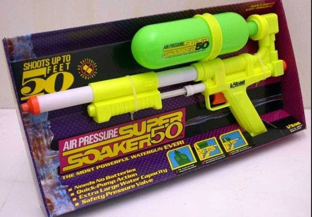 A shot of a neon yellow and green SuperSoaker 50 in its box
