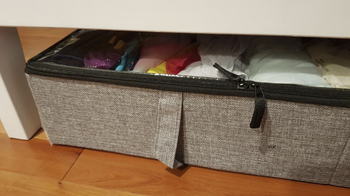 the same storage case slide underneath the bed with extra room between the bed's bottom and the case