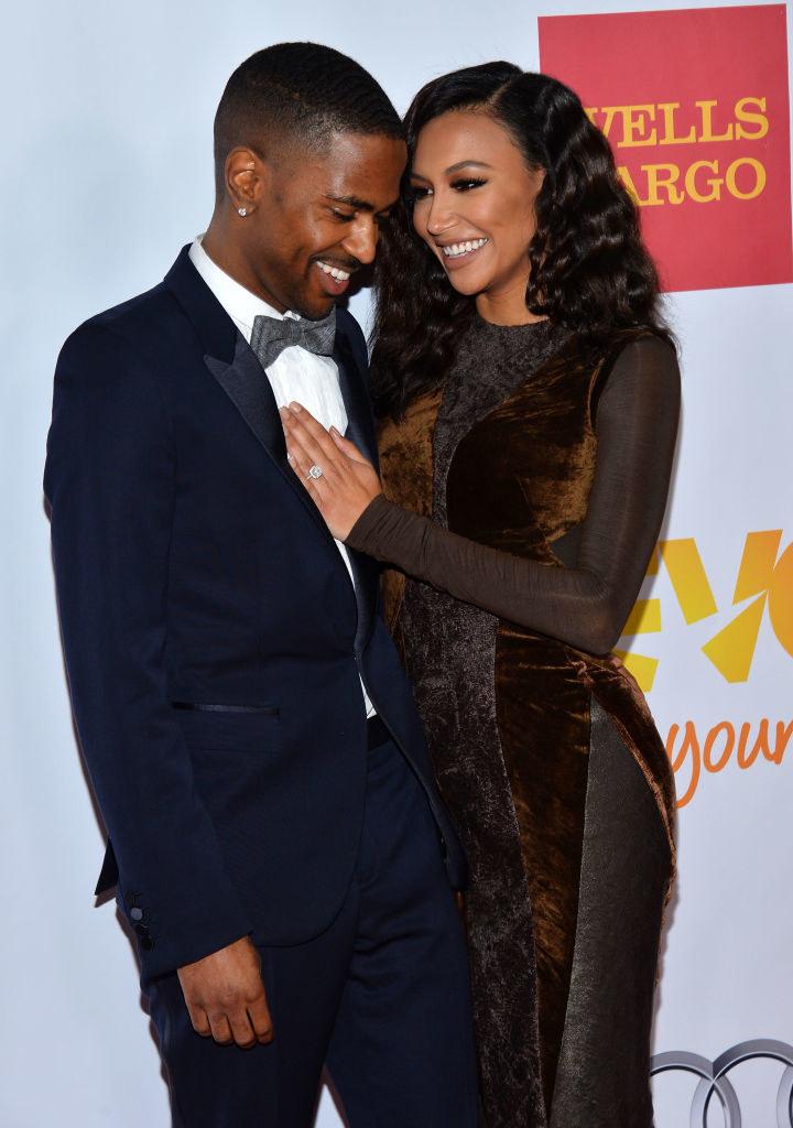 Big Sean and Naya Rivera smiling on a red carpet