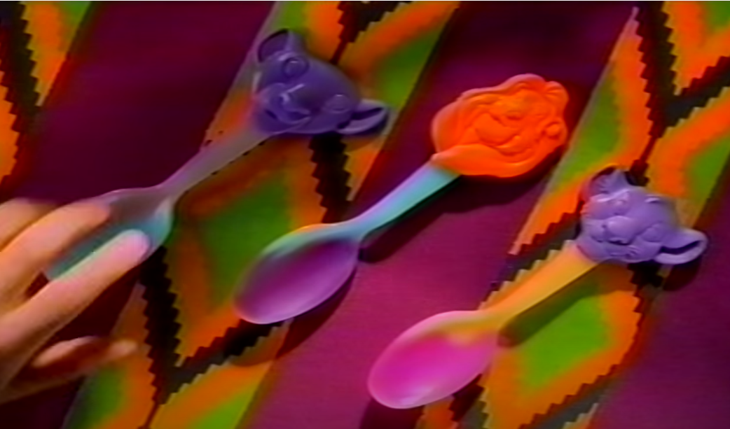Screengrab of the color changing Lion King spoons that were cereal prizes in Cheerios.
